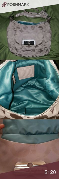 Large Coach purse Beautiful coach bag in medium grey.  Gently used with no blemishes or discoloration inside or out. Silver toned hardware. Shoulder strap is detachable. Front pocket secures with latch. Inside has 2 slip pockets & 1 zippered pocket. Rich dark teal satin lining in main compartment & front pocket. Huge inside! Coach Bags Hobos