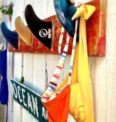 surfboard fin towel rack. Awesome idea for a beach themed bathroom