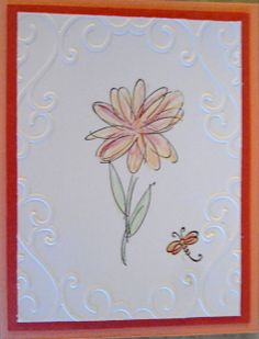 I embossed a frame on a white piece and stamped a flower; colored the flower with water color pencils. (I got a smudge on the paper; covered it with a tiny dragonfly -)...