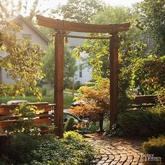 Add to Asian style with a simple arbor. Look for an arbor with clean, simple lines and a natural color. Don't make it too dramatic -- in Asian style, the simpler is usually better.