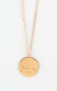 These fun, round pendents each represent a different star sign. Love how subtle each necklace is.