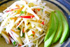 A matchstick salad composed of crunch apples and celery root, dressed with a honey habanero bitters vinaigrette.