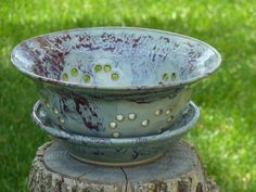 Stoneware wheel thrown colander/fruit bowl with layered glazes by Shelley Duncan