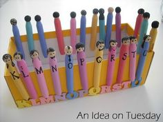 Peg people letters. Such a cute idea with the shoe box and matching letters.