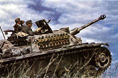 German STUG 3 with it's crew scouting the immediate area for targets.