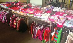 10 Tips for a Successful Garage Sale (I love the way they displayed children's clothes.) Garage Sale Pricing, Garage Sale Tips, Garage Ideas, Garage Sale Organization, Organizing, Household Organization, Baby Clothes Sale, Diy Clothes, Rummage Sale