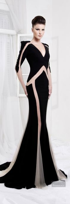 Dynamic Long Sleeve Black Evening Gown with sheer lines. Let us create a lovely black formal dress like this for you in your size and with any change you may need. Custom evening dresses are our specialty. http://www.dariuscordell.com/featured/custom-evening-dresses-couture-formal-ball-gowns/