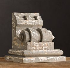 Antiqued Wooden Corbel from Restoration Hardware. Use for bookends on the console table.