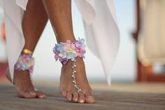 Violets shines in the sun beach wedding barefoot sandals