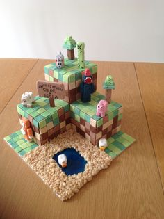 Minecraft cake with Creeper, Stampy cat, Ballistic Squid, pig, sheep, dog and ducks.