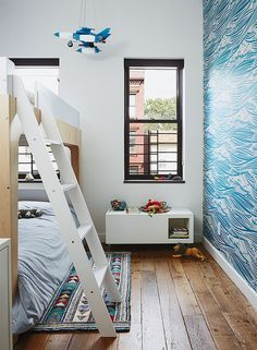 Magid selected lively Whitby wallpaper by Mini Moderns for Linus's room, along with Oeuf's Perch bunk bed. The homeowner found the light-up rocket-ship mobile on a trip to Mexico City.- Greenpoint, Brooklyn house - Noroof Architects
