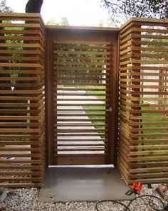 Out of all the cedar fence gate designs out there, this gorgeous, rustic wooden fence is the perfect touch as an entranceway to the garden! Fence gate ideas and design. Backyard Fences, Garden Fencing, Backyard Landscaping, Pool Fence, Backyard Ideas, Bamboo Fence, Cedar Fence, Brick Fence, Front Yard Fence
