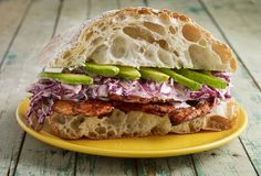 Cesina and Creamy Slaw Ciabatta Sandwich... Cesina is a thinly sliced pork that is marinated in a guajillo chiles, cider vinegar and herbs and then grilled. It is outrageously good!