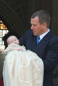 royalattire:  Peter Phillips holding his first daughter Savannah Anne Kathleen Phillips, b. December 29, 2010, at her christening on April 23, 2011