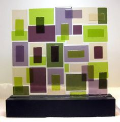 Mid Century Modern abstract art glass sculpture plays with the combination of purples and lime green. This piece would make a great addition in