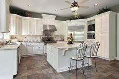 Kitchen. Cool Refrigerator Also Floor Tile And Iron Bar Stool On Beautiful White Kitchen Design Plus Ceiling Fan: Cooking Delicious Cake In ...