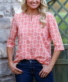 Slip into flawless style with this fun top. A pretty print adorns its stylishly simple silhouette, while a notch at the collar and three-quarter sleeves give it a casually classy polish.Size note: For best fit, please refer to size chart.100% cottonHand wash; hang dry