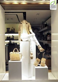 02bf02b4018d9 Cubes show off accessories in Burberry window displays Summer 2012 Budapest