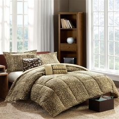 Take a walk on the wild side with the Talia Comforter Set. The softspun fabrication on the top of bed gives a very soft hand feel while the cheetah animal print adds a punch to your current décor. Down alternative fill and box quilting provide warmth for any time of year. Two decorative pillows feature fabric manipulation and embroidery to enhance the top of bed.