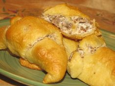 Sausage Breakfast Rolls from Food.com: This is a must have for breakfast. I made this one sunday morning and my husband loved it so much he asks for it every sunday. If you make the rolls with a lot of the mixture only one package of cresent rolls is needed. If you make the rolls with a smaller amount there may be enough for 2 packages of cresents. You can also use biscuit rolls if you like.