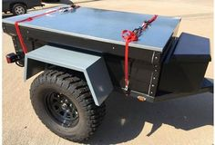 Chris bringing home the steel framed, aluminum covered cover he had made for his M-Series M416 trailer