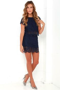 You'll fondly reminisce on all the good times you've had (and will have!) in the Turn Back Time Navy Blue Lace Two-Piece Dress! Navy blue eyelash lace overlay shapes a cute crop top with a round neckline and short sleeves. A second layer of lace drops below the scalloped hem to create a sheer, tiered look. Matching skirt finishes off the set with its figure-accentuating fit and tiered mini-length hem. Top has keyhole and button closure at back. Skirt has hidden back zipper/clasp. Small top…
