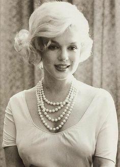 Beautiful Marilyn Monroe, looking so sweet in pearls and a simple dress.