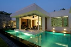 Indian studio Atelier dnD has completed the Dinesh Mills Bungalow in 2010. This 6,000 square foot contemporary residence is located in just outside Vadodara city, the third most populated city in the State of Gujarat in western India.