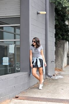 My Style Vita. Grey t-shirt with print+black leather mini skirt+white sneakers+chambray shirt+black aviator sunglasses. Summer Outfit 2016