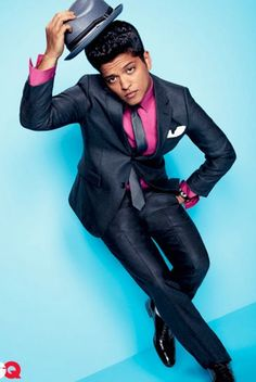 "Bruno Mars... love his new song ""Locked out of Heaven"". Its stuck in my head like crazy! :P"
