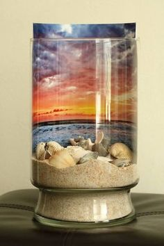 Sand and sea shells against a sunrise backdrop; in a jar.- Sand and sea shells against a sunrise backdrop; in a jar. DIY Sand and sea shells against a sunrise backdrop; in a jar. Seashell Art, Seashell Crafts, Beach Crafts, Seashell Projects, Sand Projects, Vacation Memories, Jar Crafts, Beach House Decor, Beach Art