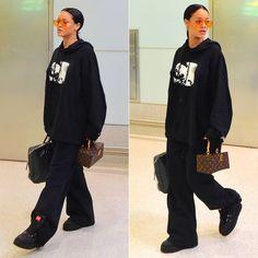 Rihanna Fenty Puma rubberized boots, graphic hoodie, triple waistband sweatpants, Gentle Monster x Opening Ceremony Zhora Ori sunglasses, Prada Saffiano padlock briefcase, Louis Vuitton Twisted Box handbag