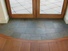 tile entryway transition to wood