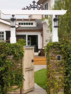 Spring is almost here! Time to start thinking about curb appeal. How about adding an arbor, gate and lanterns to your front entry? LOVE THIS!