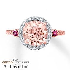 This captivating ring from the Earthly Treasures Smithsonian® collection features a round morganite encircled with diamonds totaling 1/8 carat in weight. A rhodolite garnet lends colorful contrast to either side of the center while bezel-set diamonds adorn each profile. Morganite is pink beryl. Earthly Treasures Smithsonian® Morganite has been treated to permanently create its color. Exclusively available from Jared® the Galleria of Jewelry. Diamond Total Carat Weight may range...