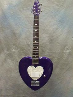 Purple & silver heart electric guitar