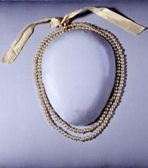 Abigail Adam's necklace made of galss imatation pearls.  The ribbon is a prop    First Ladies' Fashions  National Museum of American History