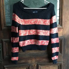 American Eagle striped sweater Comfy sweater by American Eagle size S. This is a thicker knit sweater, perfect for colder weather and the stripes are a navy and pink-like color. In great condition! American Eagle Outfitters Sweaters Crew & Scoop Necks