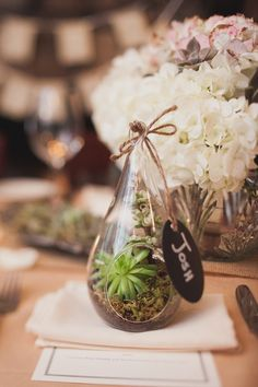 Boho bride mini terrariums for seating placement