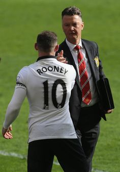 Louis van Gaal congratulates Wayne Rooney following @manutd's 2-1 win over Liverpool at Anfield in March 2015.