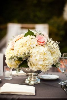 Gorgeous lush white hydrangea, blush pink roses and dusty miller