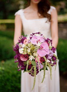purple wedding bouquet with Purple Phalaenopsis orchids  Tuberose  Green mist  Lavender and fuchsia stock  Green hydrangea  Pink ranunculus  Lemon leaf