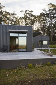 Beautifully designed Fish Creek Off Grid House offered our clients a luxurious sustainable Modular Home. New Build Designed and Built by Archiblox. Rustic Color Schemes, Rustic Colors, Dulux Natural White, Off Grid House, Modern Shed, Outdoor Baths, Fish Creek, Shed Homes, Australian Homes