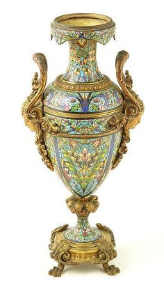 A 19th century cloisonne and ormolu vase, with allover floral decoration and female mask side handles on shell capped paw feet, 16in (40.5cm) h.