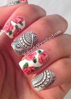 Clashing patterns: funky graphic lines juxtapose with roses for memorable nail art.