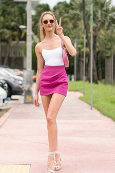 Candice Swanepoel is dressed in a Tropic of C the C One Piece Swimsuit, Jacquemus La Jupe Bambola Ruched Mini Skirt, and Jacquemus Jewelled Sandals in Miami. skirt skirt skirt skirt outfit skirt for teens midi skirt Streetwear Mode, Streetwear Fashion, Pink Skirt Outfits, Hot Pink Skirt, Candice Swanepoel Style, Cool Street Fashion, Star Fashion, Miami Fashion, 80s Fashion