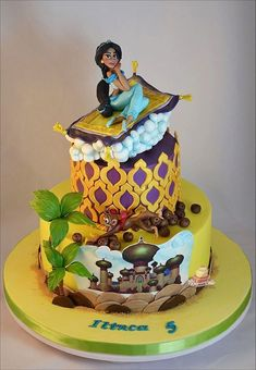 This Terrific Aladdin Cake features Jasmine riding the magic carpet over Agrabah. A picture of Agrabah is on the side of the cake. The top layer of the cake looks like one of the spires of the royal palace. Jasmine Birthday Cake, Aladdin Birthday Party, Aladdin Party, 5th Birthday Cake, Jasmine Party, Disney Themed Cakes, Disney Cakes, Theme Cakes, Fun Cakes