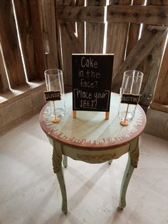Antique green table with sign two glass vases
