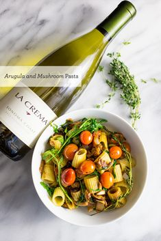 Rustic Vegan Arugula and Mushroom pasta with a light fresh tomato and chardonnay sauce-—this is an insanely delicious but incredibly easy dish!