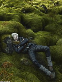 Chiseled features: In one shot 6ft 3in Lucky - who boasts than 1.2 million Instagram followers - is seen laying on a bed of green moss, while he coolly stares off into the distance